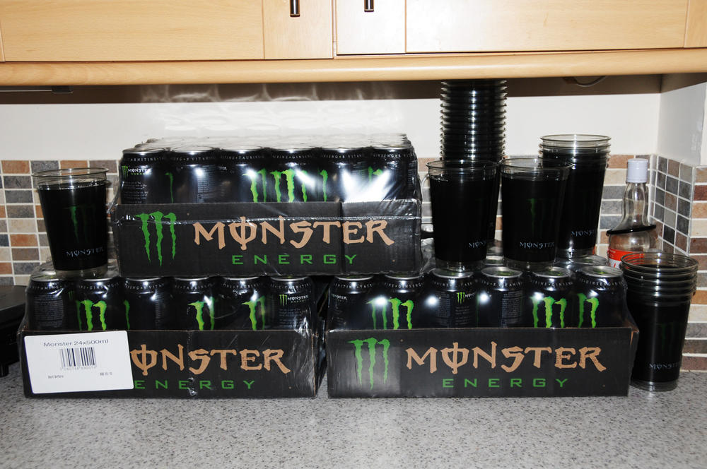 three crates of monster energy drink